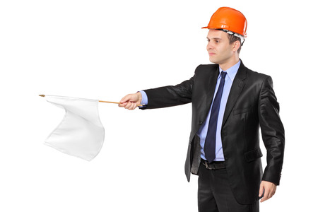 posing  agree: Construction worker waving a white flag isolated on white background Stock Photo