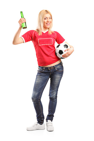 pilsner beer: Full length portrait of a female sports fan holding beer and a football isolated on white background Stock Photo