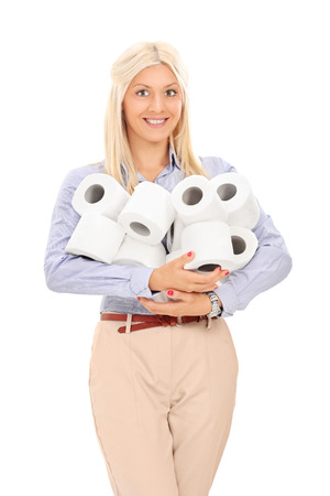 Woman holding a pile of toilet paper rolls isolated on white background photo