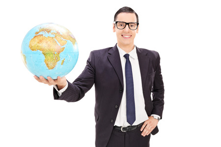 mogul: Happy young businessman  holding a globe isolated on white background