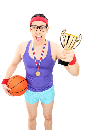 Basketball player holding a golden trophy isolated on white background photo
