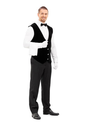 hospitality staff: Full length portrait of a professional waiter with a towel around his arm isolated on white background Stock Photo
