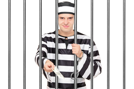 jailhouse: Prisoner offering bribe to someone behind bars isolated on white
