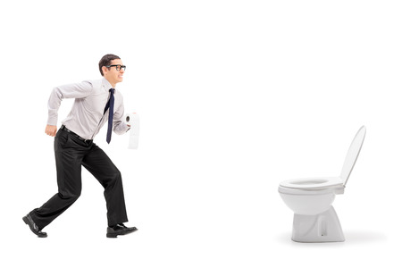 Man rushing to a urinal and holding toilet paper isolated on white