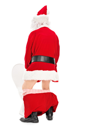 the piss: Santa Claus taking a piss in a toilet isolated on white background, rear view