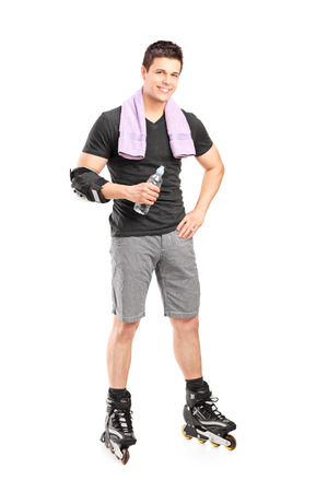 Full length portrait of a man on roller skates holding a water bottle isolated on white background  photo