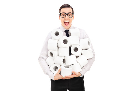 toilet paper: Excited man holding a pile of toilet paper isolated on white background