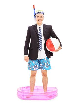 diving pool: Full length portrait of a businessman with snorkel standing in a small pool isolated on white background