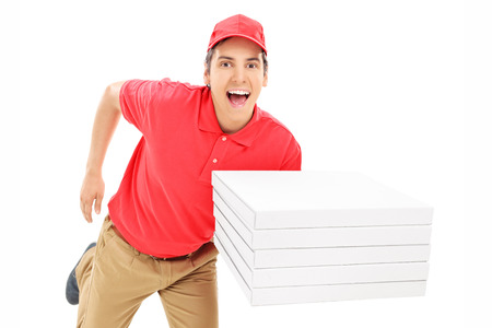 Fast pizza delivery guy running isolated against white background photo