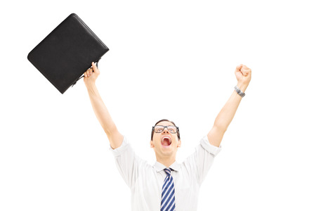 leather briefcase: Happy male holding a suitcase and gesturing happiness with raised hands isolated on white background