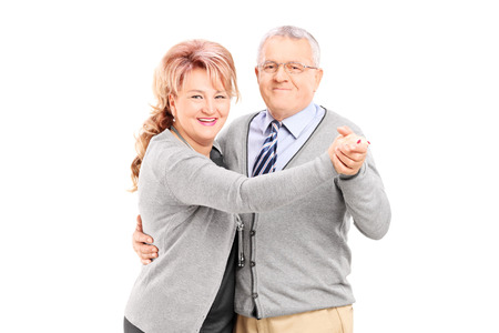 Mature couple dancing tango isolated on white background photo