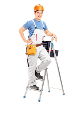 Full length portrait of a male electrician standing on a ladder isolated on white background photo