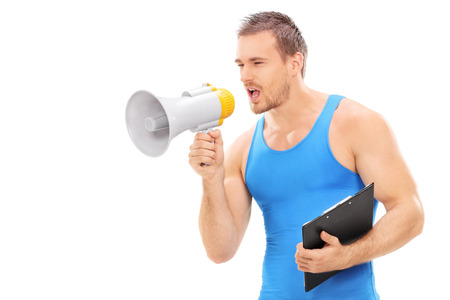 motivating: Fitness instructor shouting on a megaphone isolated on white background