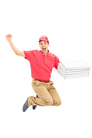 overjoyed: An overjoyed pizza delivery guy jumping isolated on white background Stock Photo