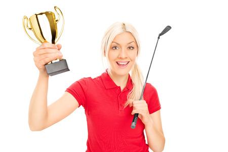 euphoric: Female golfing champion holding a trophy isolated on white background