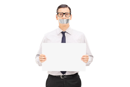oppressed: Male hostage holding a blank banner isolated on white background Stock Photo