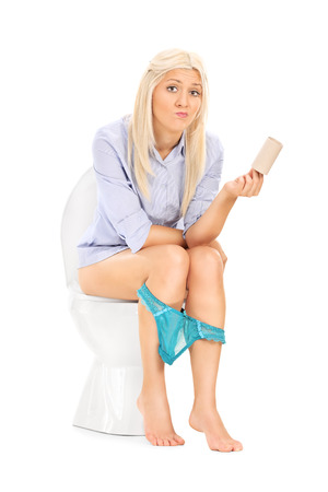 urinating: Sad woman holding an empty toilet paper roll isolated on white background