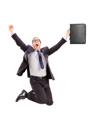 delighted: Delighted businessman jumping out of joy isolated on white background