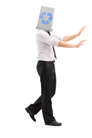 roving: Lost man with a recycle bin over his head isolated on white background
