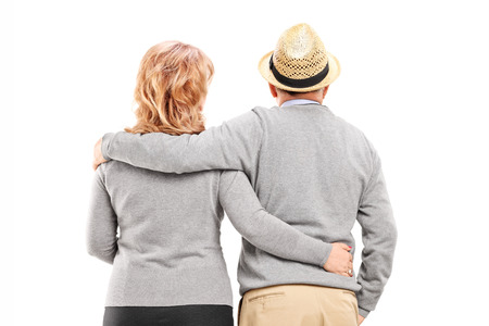 man woman hugging: Lovely mature couple isolated on white background, rear view