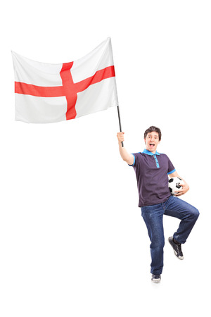 Full length portrait of a football fan holding an English flag isolated on white background