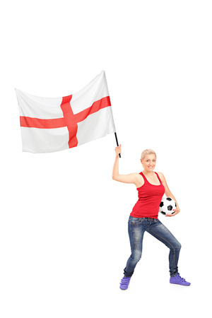 Full length portrait of a female football fan waving an English flag isolated on white background Stock Photo