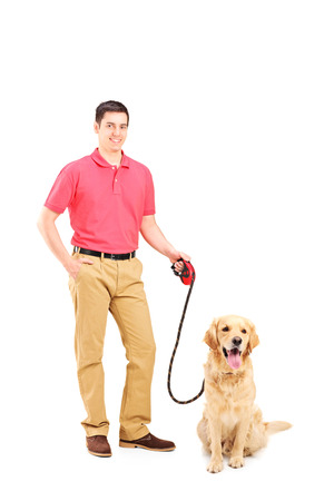 pet leash: Young man holding a dog on a leash isolated on white background Stock Photo