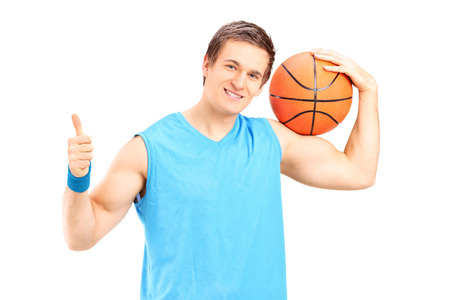 Basketball player giving a thumb up isolated on white background photo