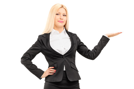 Blond businesswoman gesturing with hand isolated on white background photo