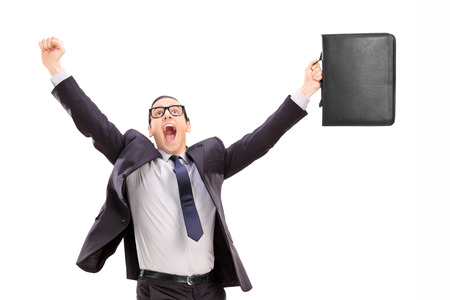 delighted: Delighted businessman isolated against white background