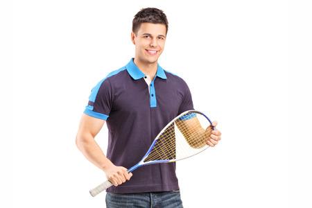 racquetball: Jugador de racquetball masculino joven aislado en fondo blanco Foto de archivo
