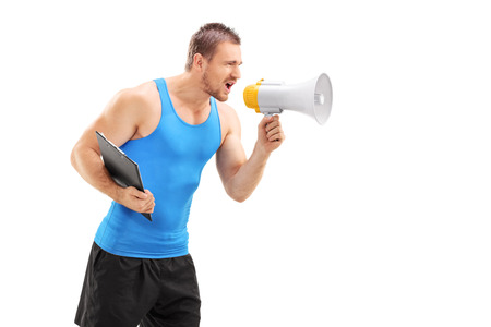 trainer device: Male fitness coach shouting through a megaphone isolated on white background
