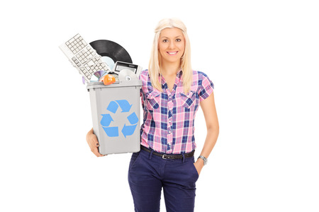recycle bin: Girl holding recycle bin full of old accessories isolated on white background