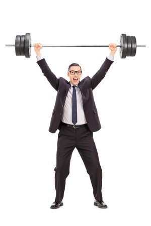 heavy weight: Full length portrait of a strong businessman lifting a heavy weight isolated on white
