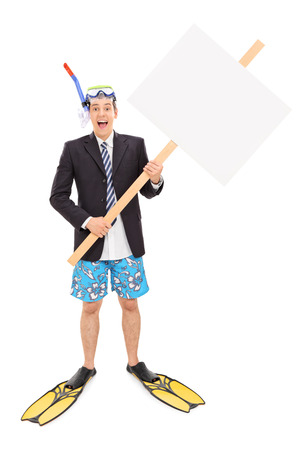 Full length portrait of a businessman with snorkel holding blank signboard isolated on white background photo