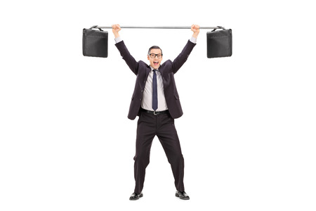 Full length portrait of a joyful businessman lifting two briefcases on a bar isolated on white background photo