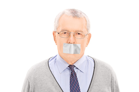 taped: Portrait of a senior with a duct taped mouth isolated on white background Stock Photo