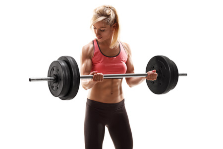 female bodybuilder: Strong muscular woman exercising with a barbell isolated on white background Stock Photo