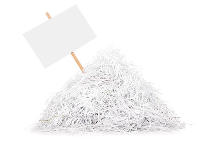 shred: Signboard stuck in a pile of shredded paper isolated on white background