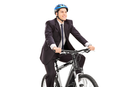 Young businessman riding a bicycle isolated on white background photo