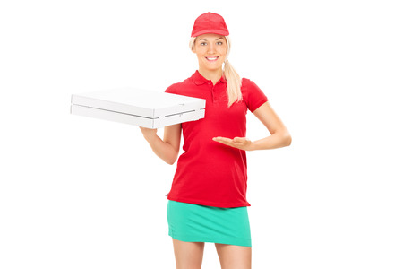 Pizza delivery girl holding two boxes isolated on white background photo