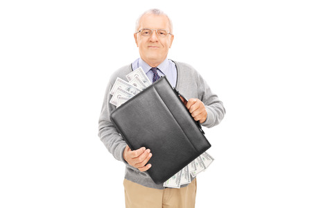 Casual senior holding a briefcase full of cash isolated on white background photo