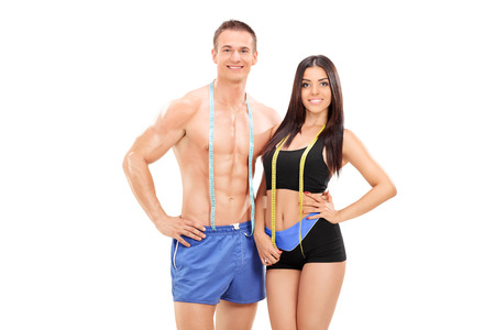Male and female athletes with measuring tapes isolated on white background photo