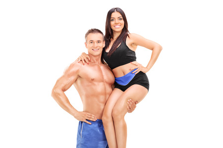 boy muscles: Handsome man lifting his girlfriend in one hand isolated on white background