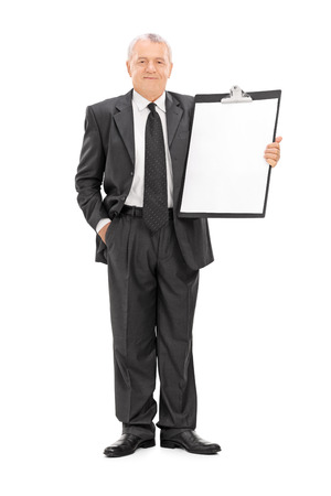 chairman: Full length portrait of a mature businessman holding a huge clipboard isolated on white background