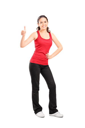 Full length portrait of a casual girl giving a thumb up isolated on white background photo