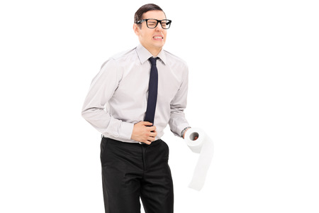 Man with stomach ache holding roll of toilet paper isolated on white background