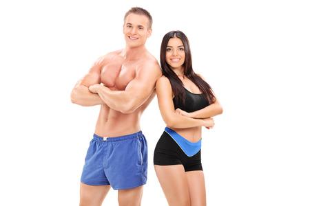 expresion corporal: Masculinos y femeninos Sexy atletas posando aislados sobre fondo blanco