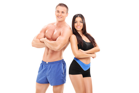 body expression: Sexy male and female athletes posing isolated on white background