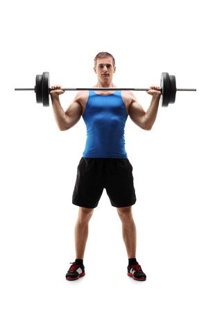 weight lifting: Full length portrait of a man in sportswear exercising with a weight isolated on white background Stock Photo